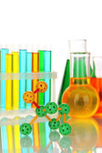 Molecule model and test tubes with colorful liquids isolated on white — Stock Photo
