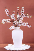 Beautiful blooming branches in vase on pink background — ストック写真