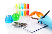 Hand scientist writing formulas isolated on white — Stock Photo