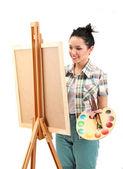 Pintor de mulher jovem e bonita, no trabalho, isolado no branco — Foto Stock