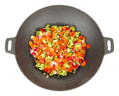 Vegetable ragout in wok, isolated on white — Stock Photo