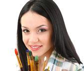 Pintor de mulher jovem e bonita com escovas, isolado no branco — Foto Stock