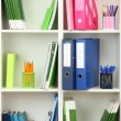 White office shelves with different stationery, close up — Stock Photo #24856937