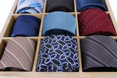 Neckties in wooden box close-up — Foto Stock