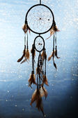 Beautiful dream catcher on blue background with lights — Foto Stock