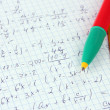 Math on copybook page closeup — Stockfoto