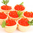 Red caviar in tartlets on white plate close-up — Stock Photo