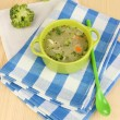 Diet soup with vegetables in pan on wooden table close-up — Stock Photo #24938451