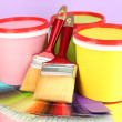 Set for painting: paint pots, brushes, palette of colors on lilac background — Foto Stock