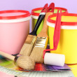 Set for painting: paint pots, brushes, paint-roller, palette of colors on lilac background — Stock Photo #24938513