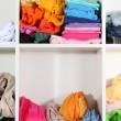 Clothing scattered on shelves — Stock Photo