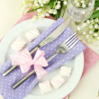 Table setting in violet and pink tones on color wooden background — Stock Photo #24938947