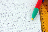 Math on copybook page closeup — 图库照片