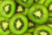 Kiwi slices as background — Stock Photo