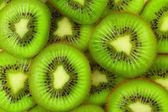 Kiwi slices as background — Stock Photo