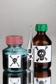 Deadly poison in bottles on grey background — Stock Photo