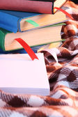 Many books with bookmarks on plaid close-up — Stock Photo