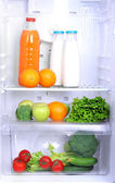 Open refrigerator with vegetarian food — Photo