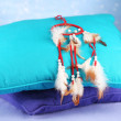 Beautiful dream catcher and pillows on blue background — Stock Photo #24941065