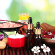 Spa composition with aroma oils on table on bright background — Stock Photo