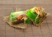 Hand-made soap on grey bamboo mat — Stock Photo