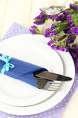 Table serving on a wooden background — Stock Photo