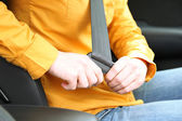 Woman attaching seat belt in the car, close up — Stock Photo
