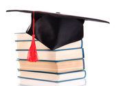 Grad hat with books isolated on white — Foto de Stock
