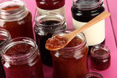 Tasty jam in banks on table close-up — Stock Photo