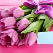 Beautiful bouquet of purple tulips on pink wooden background — Stock Photo #25029605