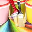 Set for painting: paint pots, brushes, palette of colors close up — Stock Photo