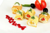 Egg rolls with cheese cream and paprika,on plate, isolated on white — Stock Photo
