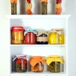 Homemade preserves on beautiful white shelves — Stock Photo #25030015
