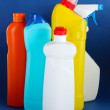 Different kinds of bath and toilet cleaners and colorful sponges, on color background — Stock Photo #25030157
