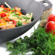 Stock Photo: Noodles with vegetables on wok close-up