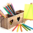 Stock Photo: Different pencils in wooden crate and easel, isolated on white