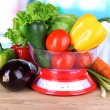 Fresh vegetables in scales on table in kitchen — Stock Photo #25031325