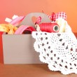 Box with the materials at hand sewing on a color background — Stock Photo #25035857