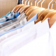 Men's shirts on hangers in wardrobe — Stock Photo #25036279