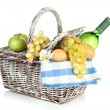 Picnic basket with fruits and bottle of wine, isolated on white — Stock Photo