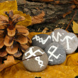Stock Photo: Fortune telling with symbols on stones close up