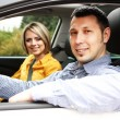 Portrait of young beautiful couple sitting in the car — Stock Photo