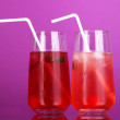 Two cherry cocktails with ice on purple background — Stock Photo