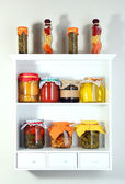 Homemade preserves on beautiful white shelves — Stock Photo