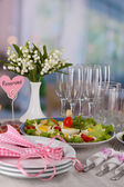 Table setting on room background — Stock Photo