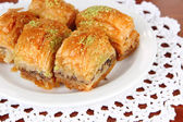 Sweet baklava on plate on table close-up — Stock Photo