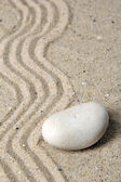 Zen garden with raked sand and stone close up — Stock Photo