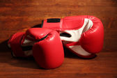 Boxing gloves on wooden background — Foto de Stock