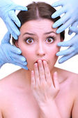 Rubber gloves touching face of young woman close up — ストック写真
