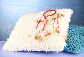Beautiful dream catcher and pillows on blue background — 图库照片